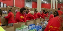 Volunteers Pack Meals for the Needy